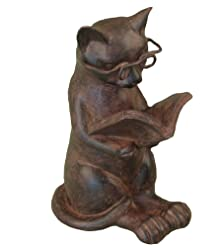 cat sitting reading figurine