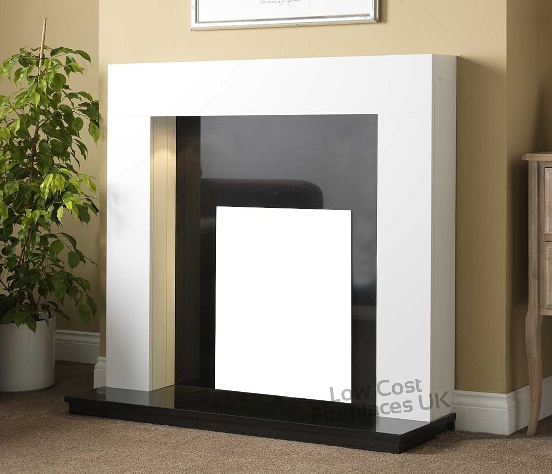 brilliant white fireplace surround black granite marble back panel