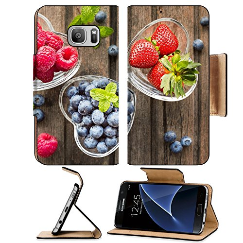 Luxlady Premium Samsung Galaxy S7 Flip Pu Leather Wallet Case IMAGE ID: 41294551 Mix of fresh berries in three glass ramekins in shape of heart on wooden background top view h ()