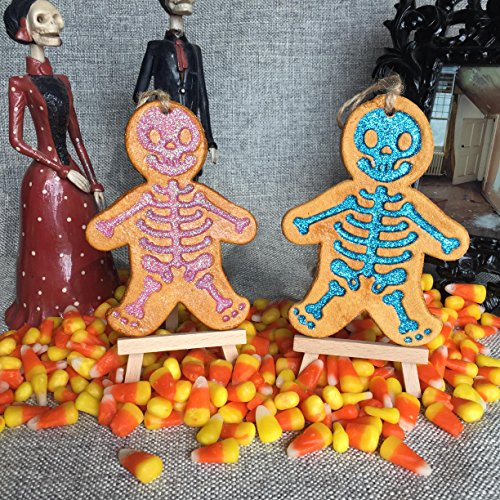 Glitter Skeleton Ornament Pink Blue glitter. Holiday, Halloween, Christmas, Day of the Dead DOD, or Gift Ornament.Made with flour, water, salt, shellac and glitter. Handmade in San Antonio Texas. for $<!--$16.00-->