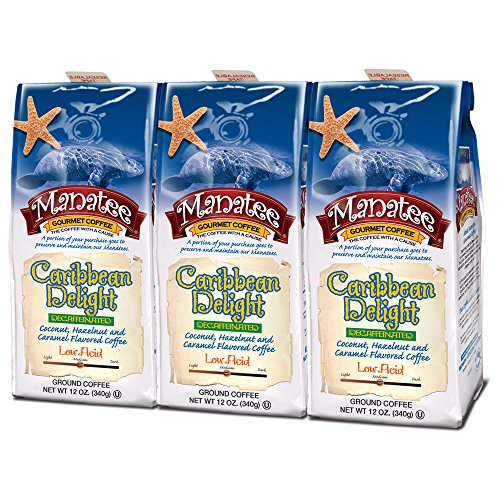 - Manatee Caribbean Delight Decaf Ground Coffee 12 Ounce (Pack of 3) Rich Medium Roast Flavored Coffee with Hints of Coconut Hazelnut and Caramel Decaffeinated Low Acid Coffee