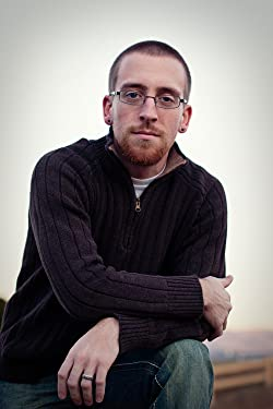 Ryan J. Rhoades