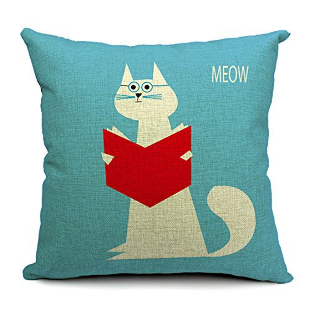 A turquoise cushion with a cartoon of a reading cat on it.