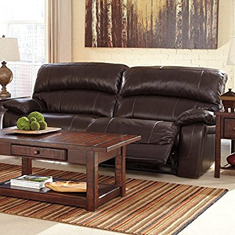 Ashley Damacio U9820081 91 2 Seat Reclining Sofa With Detailed Stitching Plush Divided Back Cushions And Pillow Padded Arms In Dark