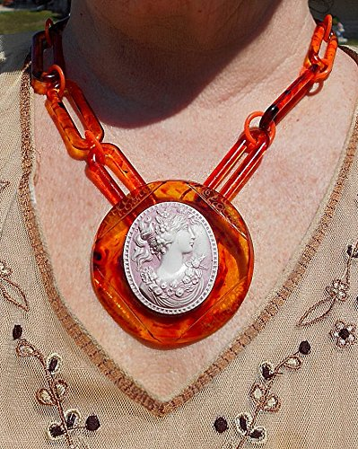 - Vintage Flowered Celluloid Cameo Set in Engraved Celluloid Tortoise Shell Pendant on Vintage Celluloid Tortoise Shell Chain Link Necklace.. Both for 149.90