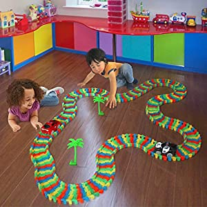 Tomi Tracks Glow in the Dark Race Car Track - 220 Flexible Pieces (11 Feet) of Cartrack - 2 Light Up Cars - Easy Assembly Toy - Racetrack Play Set Provides Kids With Hours of Car Racing Magic