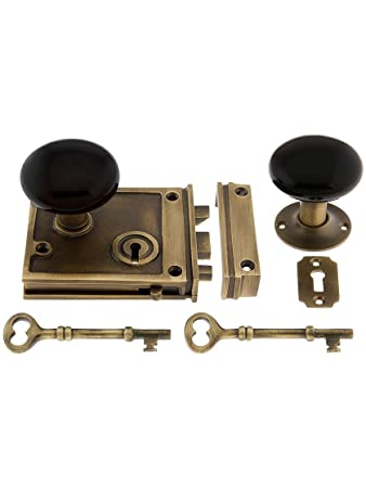 Antique Brass Horizontal Rim Lock Set With Black Porcelain Door Knobs