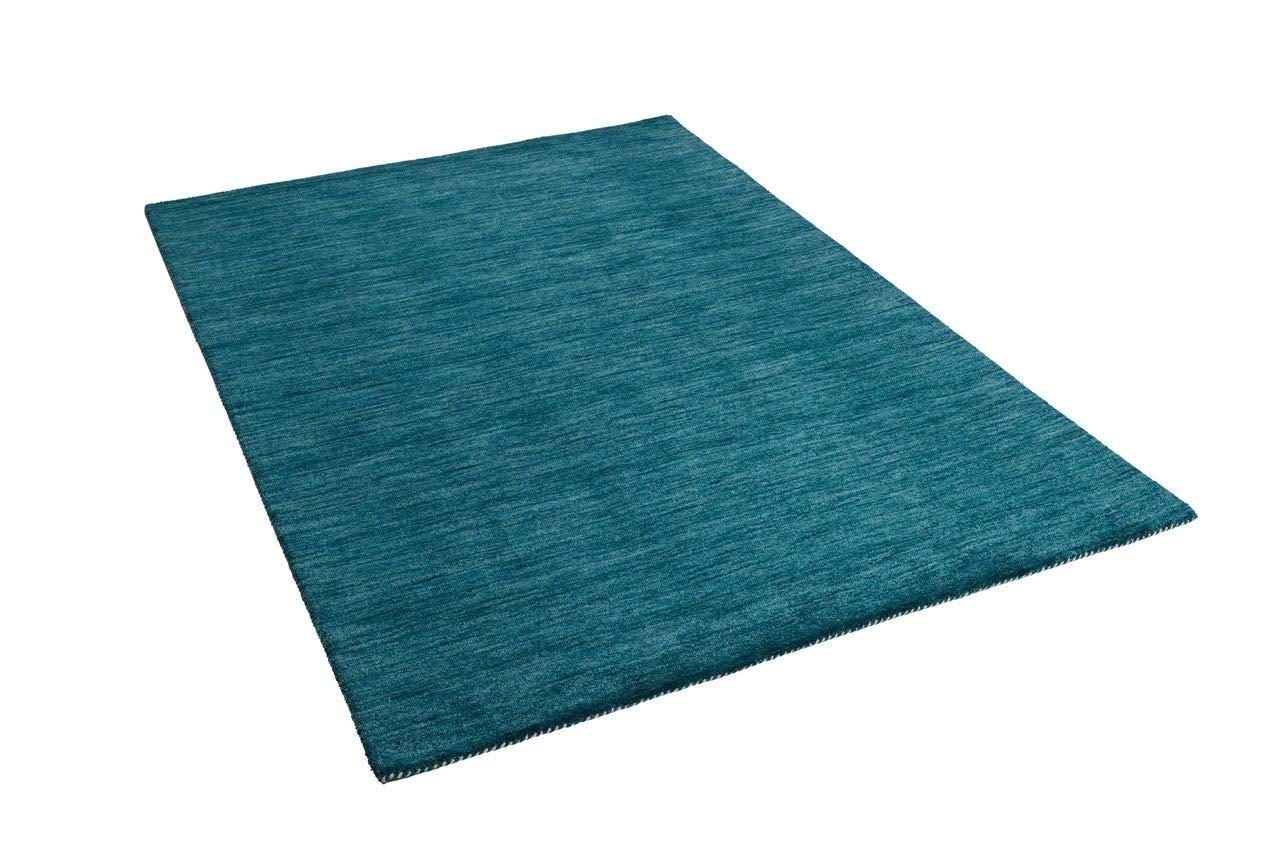 alfombras turquesas.