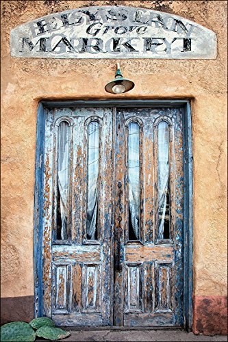 Photograph of very colorful blue American Southwest door on adobe wall with market ghost sign. Wall art photography for your home's walls as matted, un-matted or as a gallery wrapped canvas artwork.