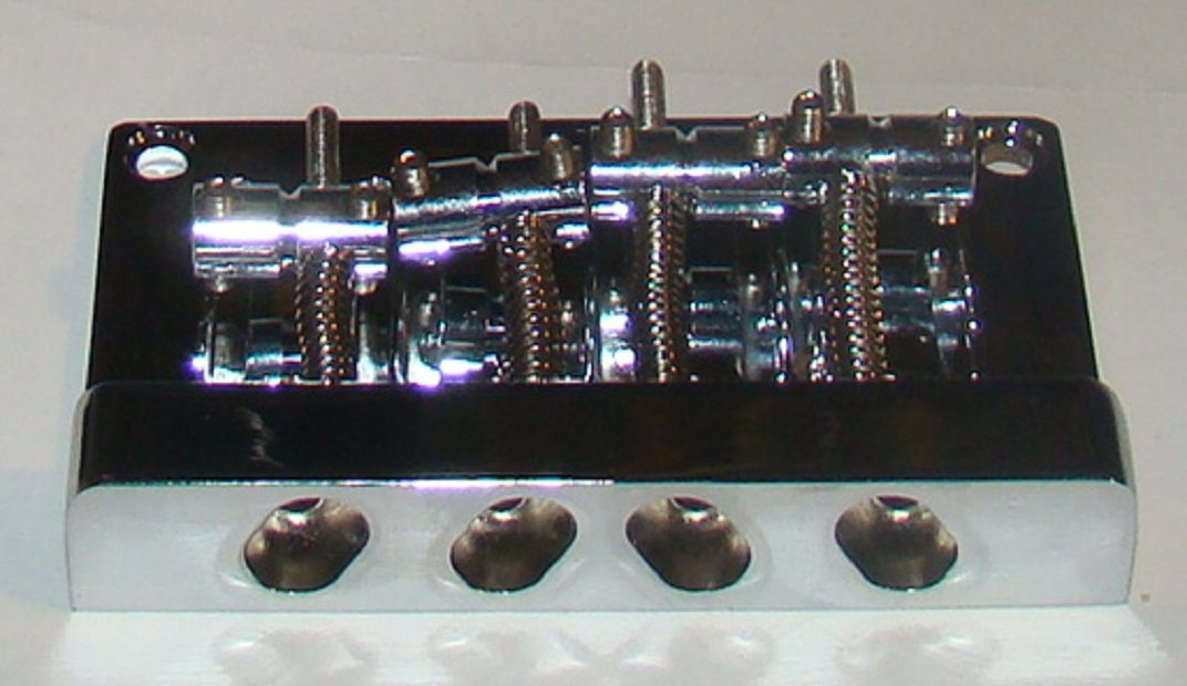 REPLACEMENT FOUR STRING BRIDGE FOR JAZZ BASS - CHROME FINISH