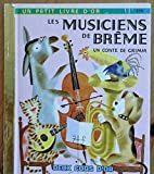 img - for Les Musiciens de Breme: Un Conte de Grimm (Un Petit Livre d'Or - A Little Golden Book) book / textbook / text book