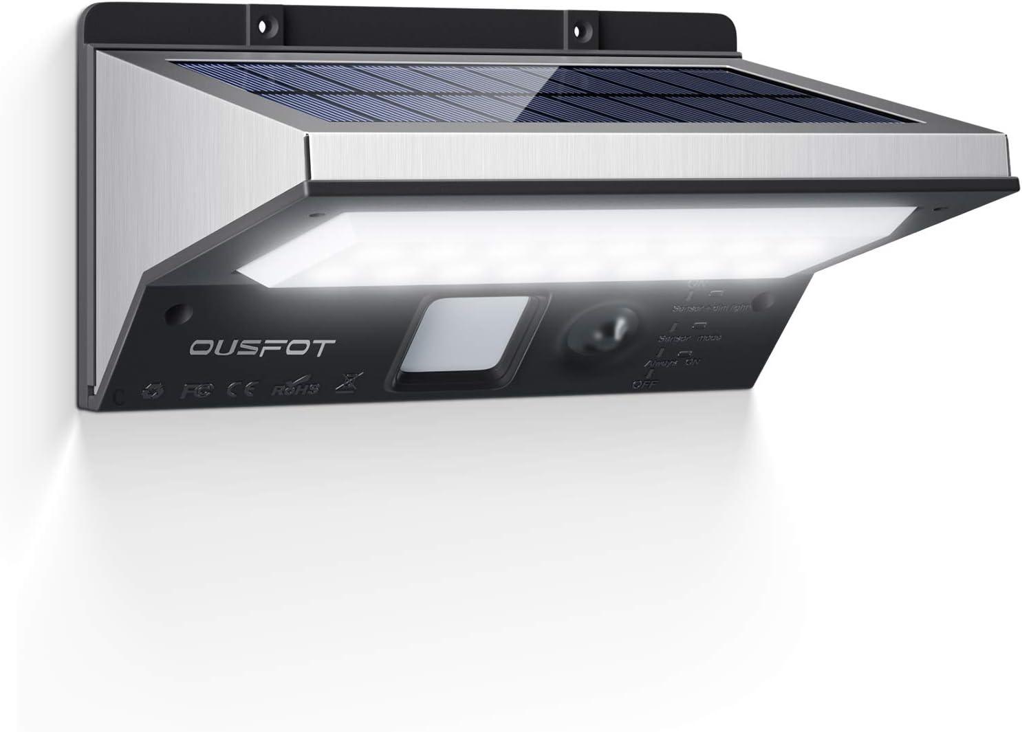 OUSFOT Luz Solar Exterior LED Foco Solar Exterior con Sensor de Movimiento Lámpara Solar Impermeable 3 Modos Gran Ángulo 120º de Iluminación 2200mAh para Jardín Muros Exteriores.