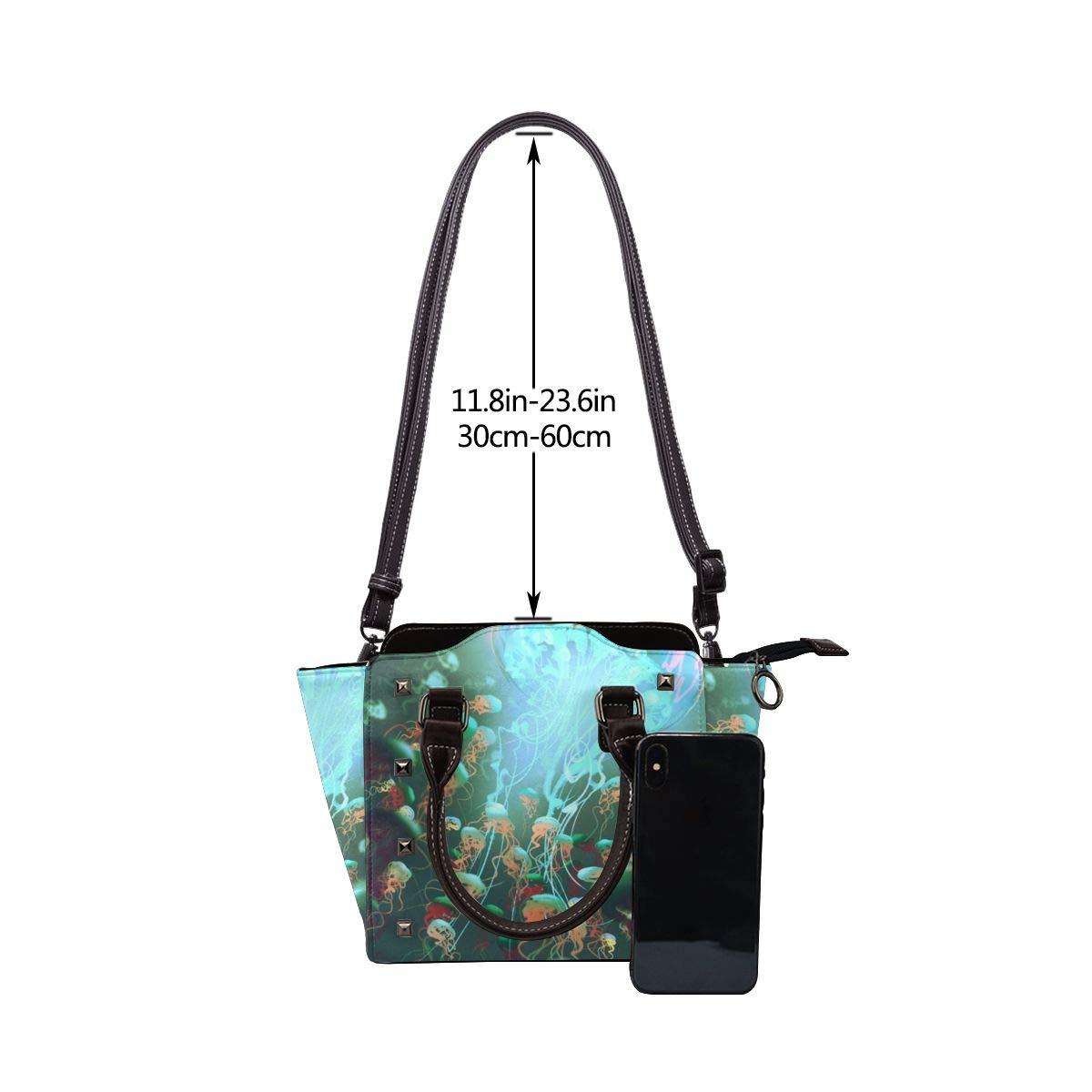 Smörfluga och malar kvinnor exklusivt mode utsökt elegant äkta läder nit axelväska Glowing Bright Jellyfish