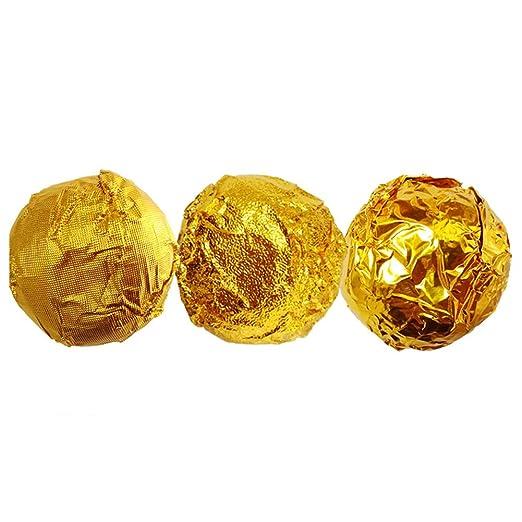 Envoltorios dorados de caramelo, caramelo y chocolate ...