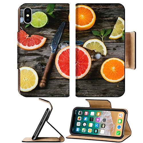 Liili Premium Apple iPhone X Flip Pu Leather Wallet Case Set of sliced citrus fruits lemon lime orange grapefruit with mint ice and vintage knife over wooden background Top view (Sliced Leather)