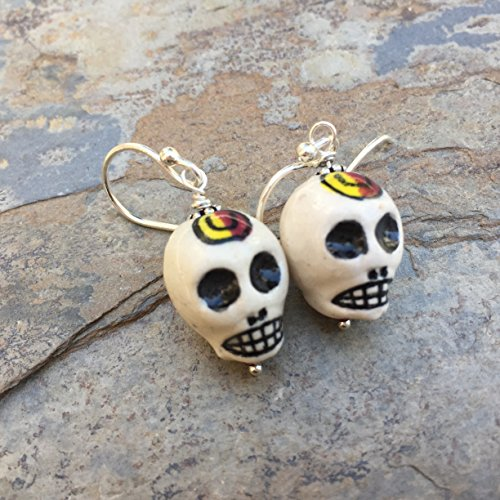 Skull Earrings with Sterling Silver]()
