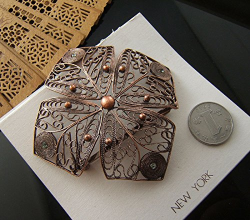 big copper handmade filigree jewelry box with a big brooch pin
