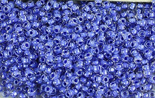 11/0 Round TOHO Japanese Glass Seed Beads #966-Crystal/Purple Lined ()
