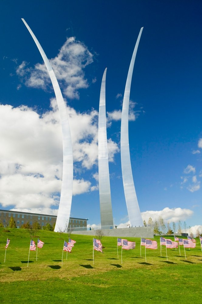 American flags at base of three soaring spires of the Air Force Memorial at One Air Force Memorial Drive Arlington Virginia in Washington DC area Poster Print by Panoramic Images 36 x 24