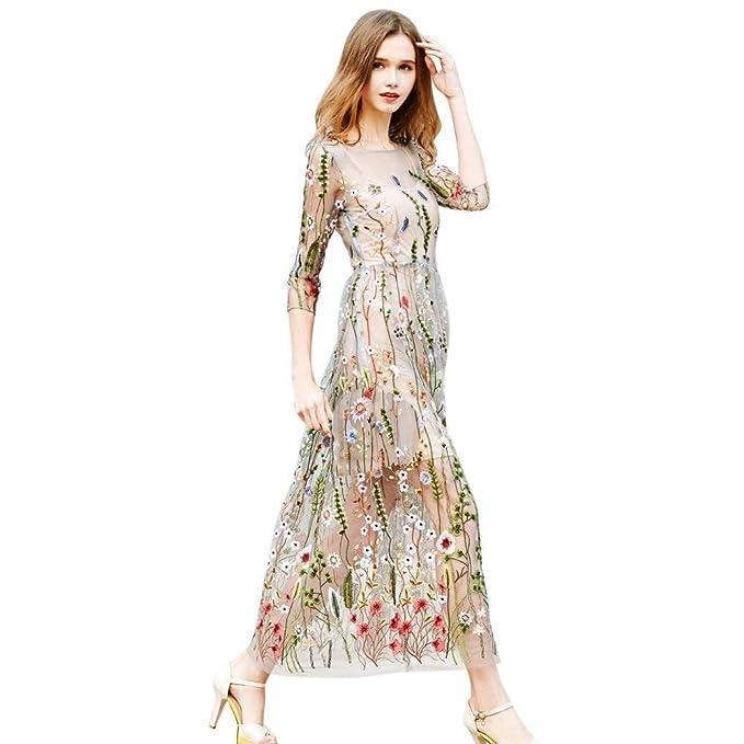 Vestido transparente floral de fiesta, mangas 3/4 y diseño floral vintaje.