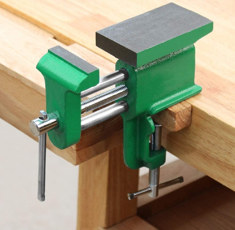 Small clamp on a bench vise with anvil