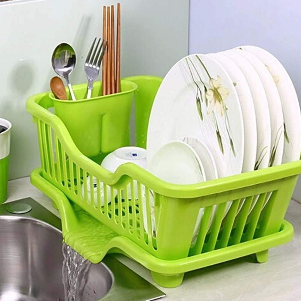 A green color storage is being used to store utensils and spoons in the image.