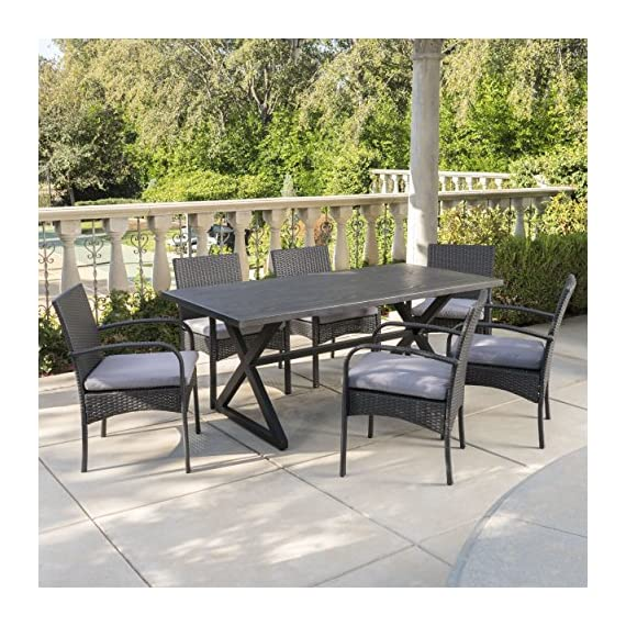 Christopher Knight Home Aster Outdoor 7 Piece Grey Aluminum Dining Set with Grey Wicker Dining Chairs and Grey Water Resistant Cushions - This clean and simple dining set combines the functionality of iron and aluminum with the comfort of wicker. Complete with a table, and 6 wicker dining chairs, this set offers comfortable seating in the great outdoors. Includes: One (1) Table and Six (6) Dining Chairs Table Material: Aluminum Table Frame Material: Steel Chair Material: Polyethylene Wicker Chair Frame Material: Iron Cushion Material: Water Resistant Fabric Composition: 100% Polyester Table Finish: Grey Frame Finish: Black Chair Wicker Finish: Grey Cushion Color: Grey Assembly Required Hand Crafted Details Table Dimensions: 35.25 inches deep x 70.50 inches wide x 29.00 inches high Chair Dimensions: 23.50 inches deep x 22.10 inches wide x 32.75 i - patio-furniture, dining-sets-patio-funiture, patio - 61J5WH8Lb L. SS570  -