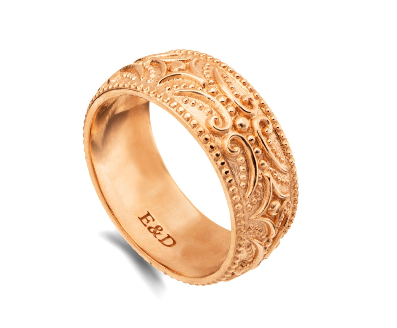 It is a graphic of Amazon.com: Solid gold wide wedding band tribal patterned boho