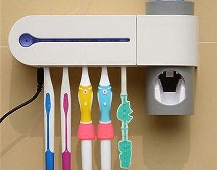 El cepillo de dientes ULTRAVIOLETA esterilizador creativo de la crema dental extrusión auto Squeeze pasta de