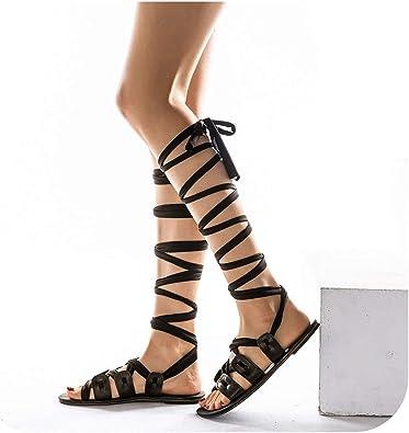 Sandalias de la playa de las sandalias del negro del verano de la muchacha