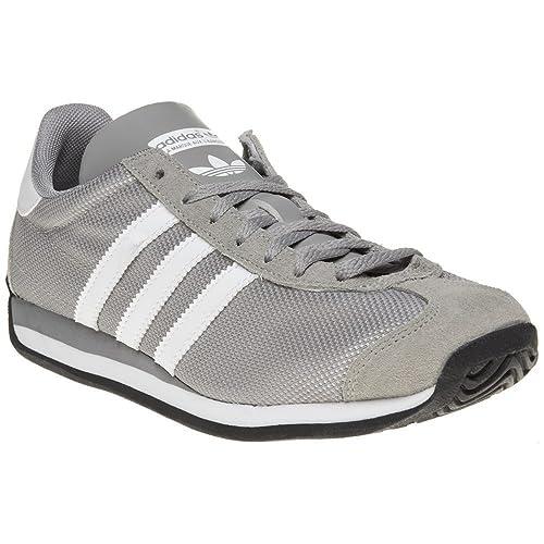 outlet store sale 89063 cd2d7 Adidas Country OG Niño Zapatillas Gris Amazon.es Zapatos y complementos