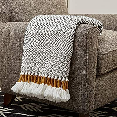 """Amazon Brand – Rivet Modern Hand-Woven Stripe Fringe Throw Blanket, Soft and Stylish, 50"""" x 60"""", Charcoal Grey and Mustard Yellow - This throw's intricate weave and fun tassels deliver style and coziness. Diamond patterns are paired with herringbone stripes, while strands of mustard color fringe are wrapped with a contrasting yarn, then allowed to fan out at the ends. 50""""W x 60""""L 100% acrylic - blankets-throws, bedroom-sheets-comforters, bedroom - 61JQJUCKg L. SS400  -"""