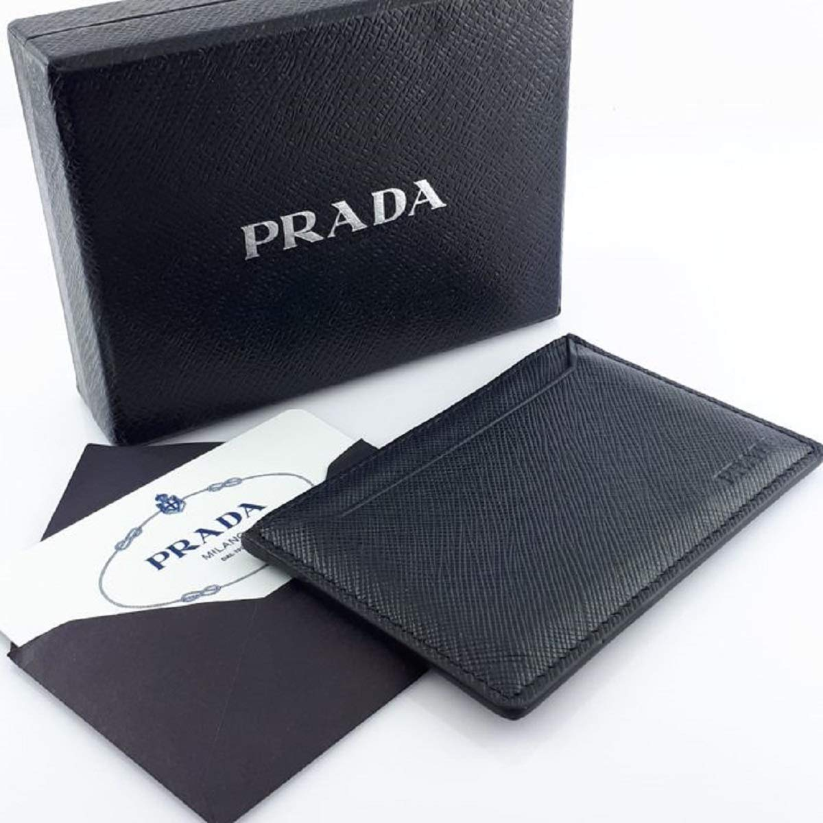 270e085b5ac69c Prada Baltico Navy Saffiano Men's Leather Wallet Credit Card Holder Case  Bill 2MC208 at Amazon Men's Clothing store: