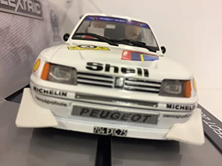 Scalextric C3751A 60th Anniversary Special Edition Packaging - Peugeot 205 T16: Amazon.es: Juguetes y juegos