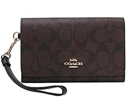 Amazon.com  Coach Flap Phone Wallet In Signature Canvas  Clothing fb33c08b5486b