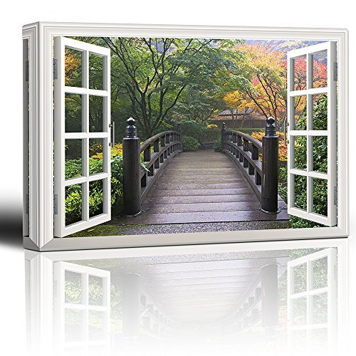 White Window Looking Out Into a Bridge Surrounded by Orange Yellow and Green Trees