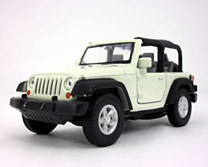 Amazon Com Welly Jeep Wrangler Rubicon 4 25 Inch Diecast Model Toy