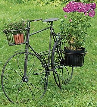 fahrrad im garten ein stck fahrrad in alt weiss rostige gartendeko gartendeko fahrrad garten. Black Bedroom Furniture Sets. Home Design Ideas
