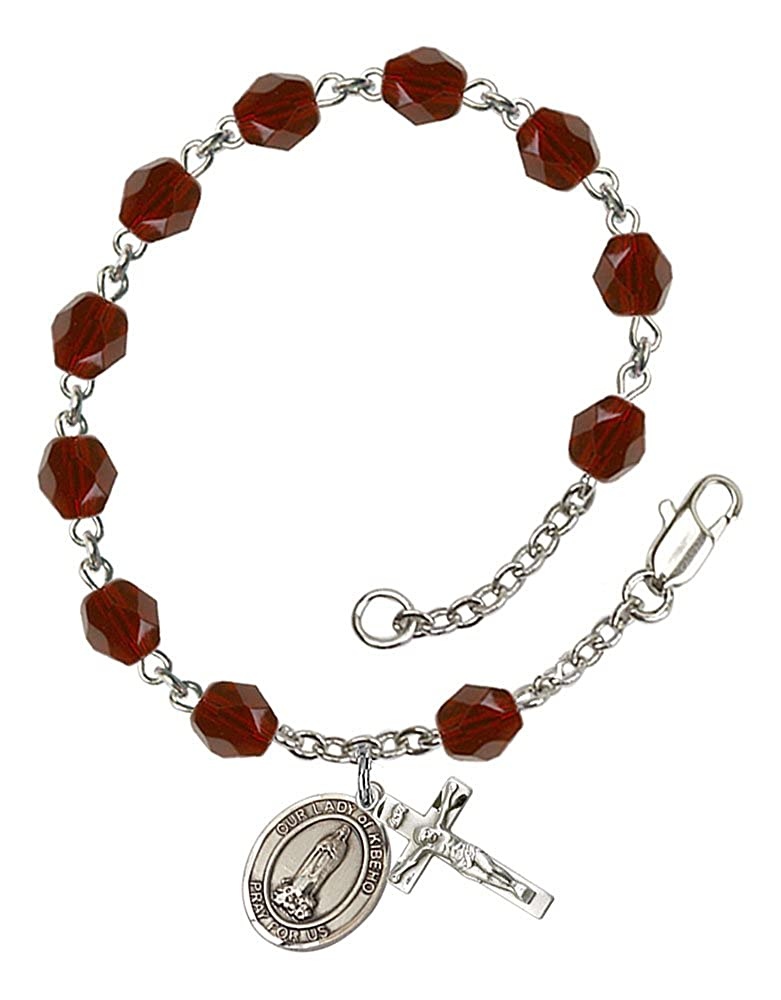 The Crucifix measures 5//8 x 1//4 Silver Plate Rosary Bracelet features 6mm Garnet Fire Polished beads Patron Saint The charm features a O//L of Kibeho medal