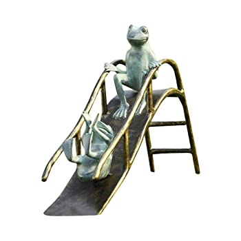 metal frogs playing on slide