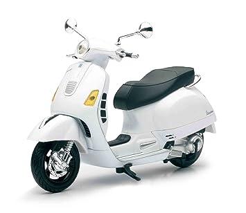 White moped vespa