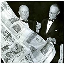 Vintage photo of Dir. Kurt Walles and dr. Gustaf Möller studying cotton papers that adorned the blue hall in the entrance hall at the National Press Club's 80th anniversary