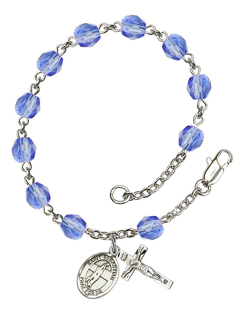 The charm features a St Sebastian//Volleyball medal Silver Plate Rosary Bracelet features 6mm Sapphire Fire Polished beads Patron Saint Athletes//Soldiers The Crucifix measures 5//8 x 1//4