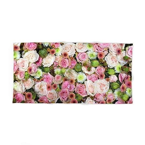 Society6 cama de rosas rosa blanco, mano y toalla de baño