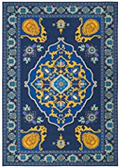 """Size:3'3"""" x 5'3"""" The thrilling Fantasy ride of your life is just a step away when the Disney Magic carpet area rug is the centerpiece of room décor. This striking replica of aladdin's one-of-a-kind carpet displays a grand central medallion gu..."""