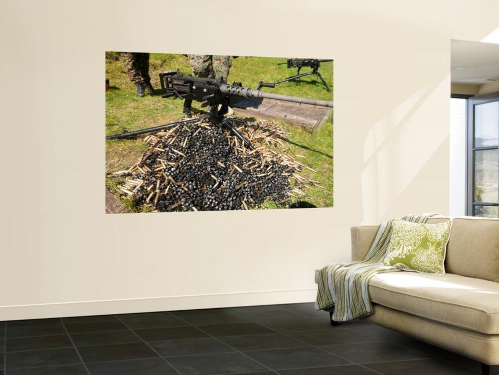 A .50 Caliber Browning Machine Gun with a Pile of Spent Cases and Links Wall Mural by Stocktrek Images 48 x 72in