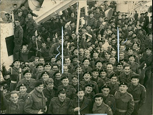 Vintage photo of TROOPS EQUIPMENT GOES ABOARD.