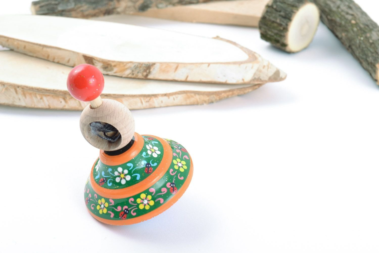 Homemade Wooden Ornamented Toy Spinning Top Painted With Eco Dyes For Children