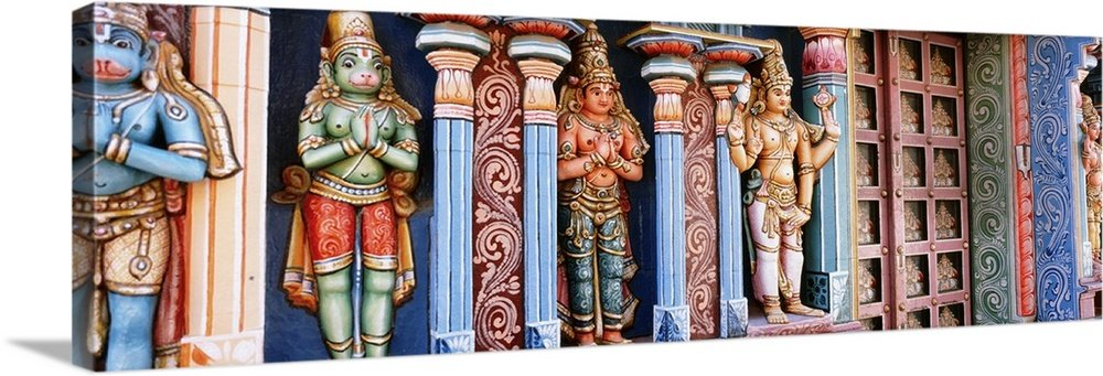 Canvas on Demand Premium Thick-Wrap Canvas Wall Art Print entitled Statues of Hindu Gods carved in a temple, Tiruchirapalli, Tamil Nadu, India 60''x20''