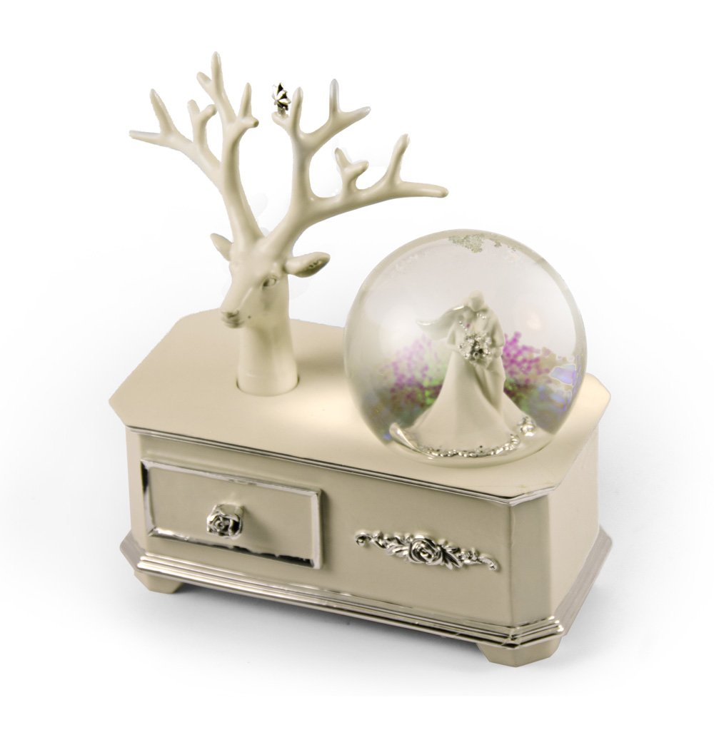 Ivory Wedding Couple Musical Snow Globe Atop Of A Silver Accented Commode - Somewhere Over the Rainbow